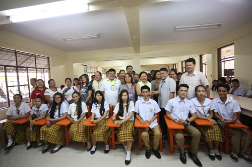 Plastic Chairs Donation Students From The Golden Acres National High School In Talon Uno Las Pinas City Gladly Sit On The Plastic Chairs Donated By